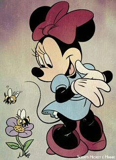 Minnie checking out the beautiful flower and the bees