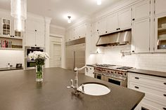 white inset shaker cabinets with ORB hardware (including exposed hinges)   Traditional Kitchen by Seattle Architect Paul Moon Design