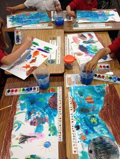 draw ocean animals, color with crayons, paint with blue water colors all around