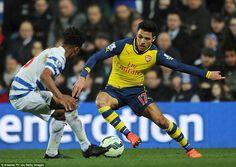 Sanchez takes on young Queens Park Rangers defender Darnell Furlong during the Premier Lea...