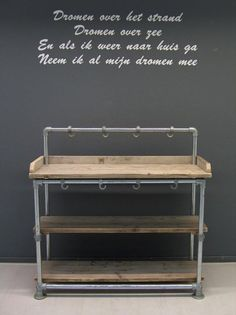 Whether you're going for a sophisticated, modern vibe or a homey, rustic appeal, industrial pipe shelves can be one way to accomplish both of these desired looks. Many people decide to build their own industrial pipe shelves that incorporate these aesthet Industrial Pipe Shelves, Industrial Living, Rustic Industrial, Pipe Shelving, Industrial Lamps, Industrial Design Furniture, Pipe Furniture, Pallet Furniture, Furniture Vintage