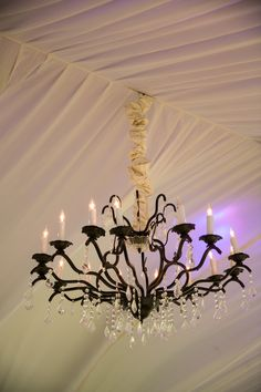 Outdoor tent reception chandelier | @johncain Photography | @beyond100
