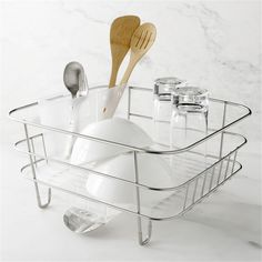Compact stainless steel and plastic rack rests on countertop or nests in sink, thanks to a removable drain spout.  Includes plastic flatware caddy. Stainless steel and heavy-duty plasticDishwasher-safeMade in China.