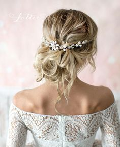 This beautiful wire hair vine featuring marquise shaped crystals in a flower design, set on bendable silver wire is a lovely finishing touch for the boho chic bride. HOW TO WEAR: - WEAR AT THE BACK OF YOUR HEAD (as shown) - Worn ear to ear at the back you do not need ribbon ties.
