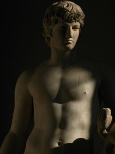 Antinous as Agathodemon. Headless marble statue completed with an Antinous' head, 130–138 CE. by Ackteon