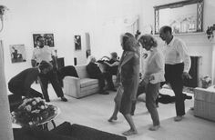 Marilyn dancing at a party at Henry  Weinstein's house, January 1962. Photo by Arnold Newman.