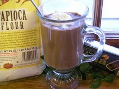 """Ghana inspired hot chocolate - Take a mug of milk and whisked in 2 teaspoons of tapioca starch (aka tapioca flour). Heat it for a few minutes, stirring every 30 seconds or so (you don't want it to thicken unevenly). After a couple of minutes, added some squares of chocolate probably 3/4 - 1 oz; the Lotte """"Ghana"""" chocolate works well, whisked it with a tiny whisk as it melts, and put it back in the microwave for about 30 seconds, then whisked it again. Add a little sugar."""