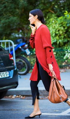 Flowy red top with black pants  | For more style inspiration visit 40plusstyle.com