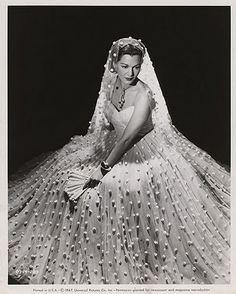 Actress Maria Montez wearing a 1947 wedding ensemble.