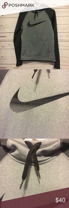 Nike gray and black therma fit hoodie xs Nike therma fit hoodie xs  in good condition. Perfect for cool nights. 18 arm to arm and 24 shoulder to hem. Nike Tops Sweatshirts & Hoodies