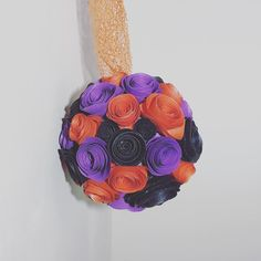 Hanging Paper Flower pomander for a Halloween decoration with a 'hidden' Mickey! #flower #pomander #paper #paperflowers #glitter #halloween #mickey #mickeymouse #disney #hiddenmickey #orange #purple #black #handmade #foreverpaperflowers