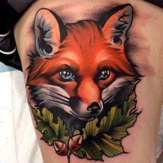 Tatuaje de zorro con ojos azules