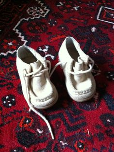 "Leslie says: ""Wow, do I have some great photos for you! (I'm almost reluctant to share them because I don't want anyone else to know that thrift stores are treasure troves.)    I'm just attaching one picture of [baby's] shoes. They're a Goodwill find; I think they were $2.99."""