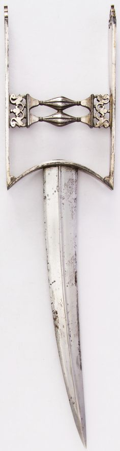 Indian katar, 18th century, H. with sheath 16 3/8 in. (41.6 cm); H. without sheath 15 1/8 in. (38.4 cm); W. 3 3/4 in. (9.5 cm); Wt. 16.8 oz. (476.3 g); Wt. of sheath 5.7 oz. (161.6 g), Met Museum, Bequest of George C. Stone, 1935. #60