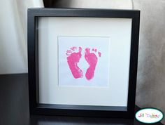 baby footprints made this on 2012/11/06 and bought a frame with three windows, one handprint, footprint and in the middle a picture of my child. Bought the ink at a craft store and the frame at walmart for 12 $
