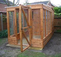 Wooden shed with enclosure and indoor shelving
