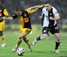 Jakob Jantscher of Sturm Graz (R) fights for the ball with Gabriel Torje of Dinamo Bucuresti (L) during their UEFA Cup group F football match on September 17, 2009 in Graz.