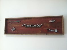SOLD!!!   Handmade reclaimed wood art adorned with vintage auto emblems.  All Chevrolet emblems: Chevrolet Apache, Corvair, Nova, Impala & Chevy flags.  Chuck will does custom work.  Dodge, Chevy, Ford.