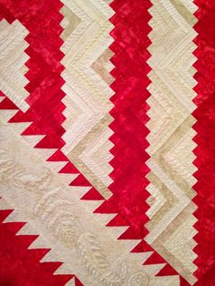 close up, Red and white log cabin quilt at the 2014 Houston International Quilt Festival:  Ruby Jubilee. Photo by The Quilting Queen Online