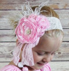 Flower feather boho style lace headband. Comes in 5 colors - Cream, Pink, Black, Purple and Brown. Match it with our outfits or your own.