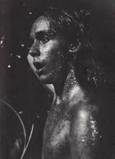 A paint covered Iggy Pop on stage