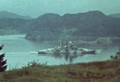 Rare original colour photo of 15 in German battleship Tirpitz in the Norwegian fjords setting typical of her war, August 1943. As a threat in being to the Arctic convoys she was constantly attacked by the British, finally being sunk by RAF Lancasters using 12000 lb 'Tallboy' bombs in November 1944.
