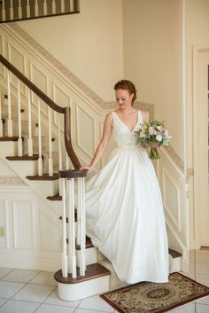 Bridal portait on the staircase...a timeless must have Photography By / http://Jeremyhessphotographers.com,Floral Design By / http://wildflowersbydesign.com