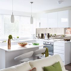 This island area not only doubles as storage and additional surface space but as a handy breakfast bar too!