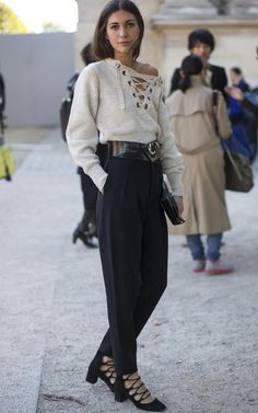 Lace-up knits found a place tucked in tailored black trousers