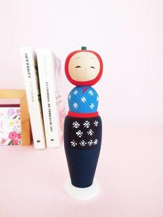 Kokeshi doll with apple-shaped head