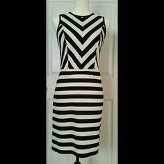NWT Ann Taylor striped dress This dress is bold and stunning! Tag says 4 but runs big. I'm a 6 and it is roomy on me. Ann Taylor Dresses Midi