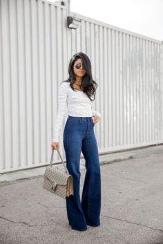 Street style | High waisted flared jeans over striped shirt