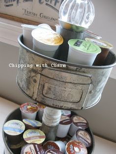 what do you get when you combine vintage cake pans, a pretty spindle and some goopy glue - a FABULOUS tiered storage stand via chipping with charm!