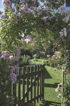 Victorian Garden;  garden gate in an extended Victorian cottage with roses