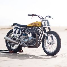 Triumph flat tracker with a Staracer frame, built by Christophe Canitrot—the race director for the popular Wheels & Waves festival, held in Biarritz each year. Flat Track Motorcycle, Tracker Motorcycle, Womens Motorcycle Helmets, Motorcycle Girls, Triumph Cafe Racer, Triumph Bikes, Honda Motorcycles, Cafe Racers, Ducati Monster S4