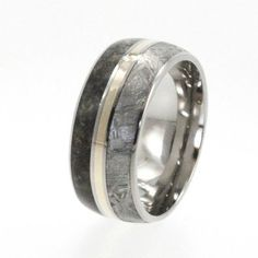Meteorite Ring / Dinosaur Bone and Meteorite with a Yellow Gold Pinstripe Titanium Ring. Talk about a badass ring!!