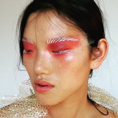 Rosey lids with graphic brows.