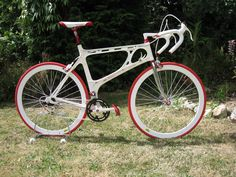 """The Kirk Precision in RWK Livery. The rear dérailleur is an Ofmega Mistral white dérailleur from about 1984, while the brake levers are Modolo """"La Vie Clair"""" team kit levers from the 1980s. The wheels were made by RWK for the bike, with Ofmega Competizione hubs (red anodised)."""