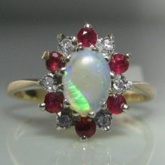 #Opal, #Diamond and #Ruby #Ring #Jewelry #The #Antiques #Room #Galway #Ireland Engagement Ring Buying Guide, Round Cut Engagement Rings, Ruby Jewelry, Jewellery, Galway Ireland, Unique Vintage, Diamond Rings, Brooch, Opals