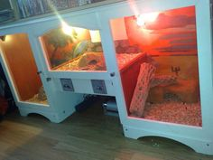 Hutch tank. Raised center for basking, side opening doors.