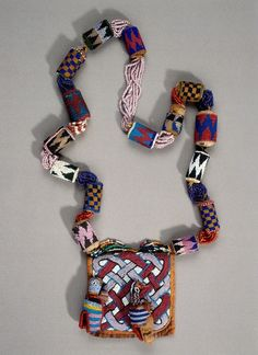 Africa | Beaded necklace from the Yoruba people of Nigeria | Leather, cloth, glass beads, cotton thread //