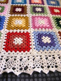 "Ellen Bloom blogs about making this Wedding Afghan. It's a great idea for using up some yarn scraps. Simple Granny Squares joined together and then finished off with an amazing edging stitch. Ellen says that the edging is from Doris Chan's ""All Shawl"" pattern on Ravelry."