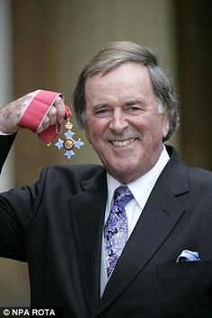 Sir Terry Wogan pictured after he was given a knighthood at an investiture at Buckingham Palacein the Queen's Birthday Honours in 2005
