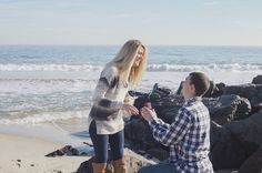 Too cute! He proposed during a family portrait photo shoot on the beach.