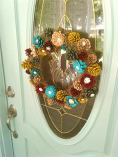 Use pine cones to make a beautiful wreath!  Love the colors, but you could do any color scheme.  #pinecone #wreath #diy