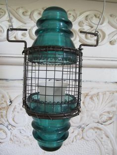 Insulator Lantern by searchnrescue2 on etsy. $45.00, via Etsy.
