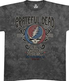 Liquid Blue Grateful Dead American Music Hall Tie Die T-Shirt Tee.  On August 13, 1975, The Grateful Dead played a legendary concert at the Great American Music Hall in San Francisco. They had been in the studio laying down the tracks for Blues For Allah, and were anxious to play the new material live. This Grateful Dead T-shirt commemorates that spectacular night. The recording of this concert became the CD One From The Vault, the first in the Dead's Vault series.  This fashion garment ...