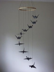 Black origami cranes provide the perfect visual stimulation for baby eyes.  This mobile would work over the crib or changing table.