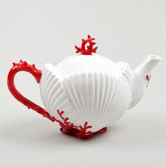 white shell teapot ....  body in shape of clamshells or seashells with recessed lid, red coral shape handle, knob and applied decoration, ceramic