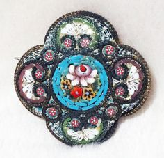 Hey, I found this really awesome Etsy listing at https://www.etsy.com/listing/182282131/micro-mosaic-brooch-vintage-italian